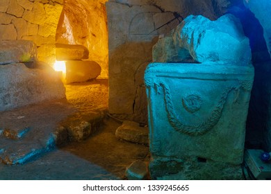 Sarcophagus (Roman period coffin) with carving of Zeus head, in a Jewish burial cave, in Bet Shearim National Park (Jewish Necropolis), Northern Israel