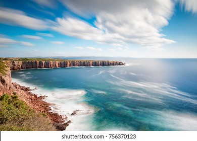 Sardegna, Carloforte, reef called La Conca. - Spectatular cliffs in a sunny day with long exposure to moove the sea and the clouds.