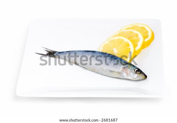 Sardine and lemons on a plate