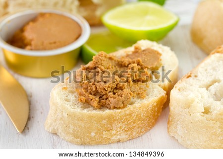 sardine paste with bread and glass of water