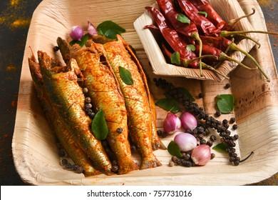 Sardine or pilchard fry fish curry with salad tasty sea food cuisine, Goa India. Popular dish in Indian coastal area restaurants Kochi Kerala.