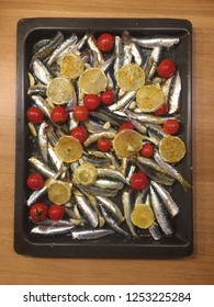 Sardines marinated in Mediterranean oil and spices ready to bake in oven tray.