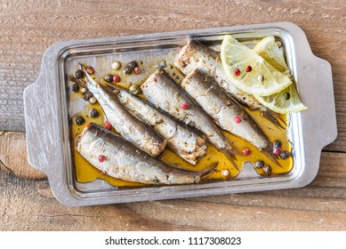Sardines on the metal plate