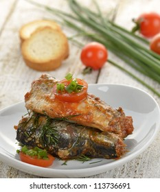 Sardines In Tomato Sauce In A White Dish