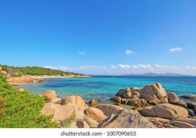 Sardinia Capriccioli sea beach. Spiaggia Capriccioli, Arzachena. Italy summer vacation. Manific view of Sardinian beach. Golden rocks. Costa Smeralda Sardegna, Italy. Luxury resort. Italian vacation.
