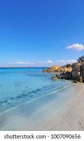 Sardinia Capriccioli sea beach. Spiaggia Capriccioli, Arzachena. Italy summer vacation. Manific view of Sardinian beach. White sea cost Costa Smeralda Sardegna, Italy. Luxury resort. Italian vacation.