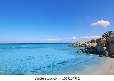 Sardinia Capriccioli sea beach. Spiaggia Capriccioli, Arzachena. Italy summer vacation. Manific view of Sardinian beach. White sand. Costa Smeralda Sardegna, Italy. Luxury resort. Italian vacation.