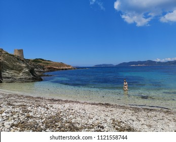 Sardinia empty beach in the summer with blue water