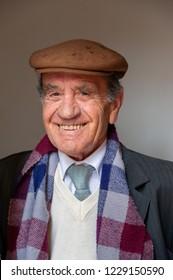 SARDINIA, ITALY - APRIL 22, 2011: Portrait of dapper smiling elderly man
