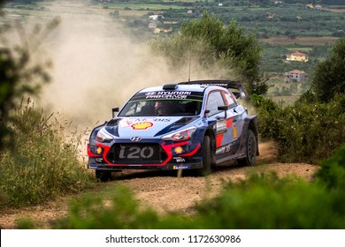 SARDINIA, ITALY - JUN 10: Belgian driver Thierry Neuville and his codriver Nicolas Gilsoul in a Hyundai i20 WRC race in the Rally Italia Sardegna 2018, on Jun 10, 2018 in Sardinia, Italy.