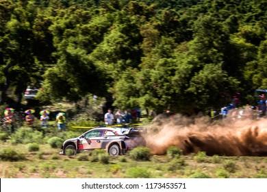 SARDINIA, ITALY - JUN 10: Belgian driver Thierry Neuville and his codriver Nicolas Gilsoul in a Hyundai i20 WRC race in the Rally Italia Sardegna 2018, on Jun 10, 2018 in Sardinia, Italy.