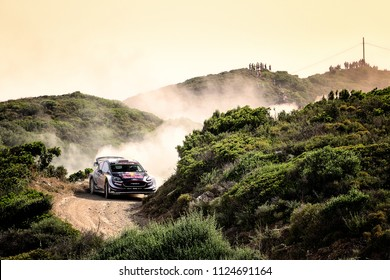 SARDINIA, ITALY - JUN 10: British driver Elfyn Evans and his codriver Daniel Barritt in a Ford Fiesta WRC race in the Rally Italia Sardegna 2018, on Jun 10, 2018 in Sardinia, Italy.