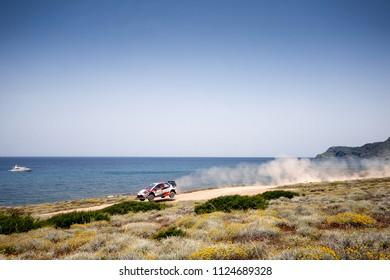 SARDINIA, ITALY - JUN 10: Estonian driver Ott Tanak and his codriver Martin Jarveoja in a Toyota Yaris WRC race in the Rally Italia Sardegna 2018, on Jun 10, 2018 in Sardinia, Italy.
