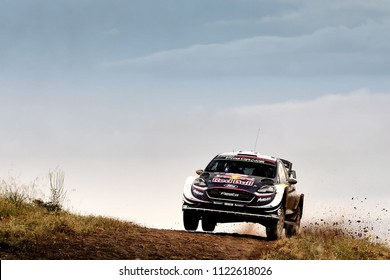 SARDINIA, ITALY - JUN 10: French driver Sebastien Ogier and his codriver Julien Ingrassia in a Ford Fiesta WRC race in the Rally Italia Sardegna 2018, on Jun 10, 2018 in Sardinia, Italy.