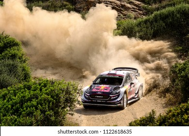 SARDINIA, ITALY - JUN 10: French driver Sebastien Ogier and his codriver Julien Ingrassia in a Ford Fiesta WRC race in the Rally Italia Sardegna 2018, on Jun 10, 2018 in Sardinia, Italy.