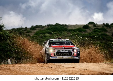 SARDINIA, ITALY - JUN 10: Norwegian driver Mads Ostberg and his codriver Torstein Eriksen in a Citroen C3 WRC race in the Rally Italia Sardegna 2018, on Jun 10, 2018 in Sardinia, Italy.