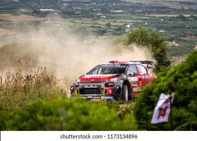 SARDINIA, ITALY - JUN 10: Norweian driver Mads Ostberg and his codriver Torstein Eriksen in a Citroen C3 WRC race in the Rally Italia Sardegna 2018, on Jun 10, 2018 in Sardinia, Italy.