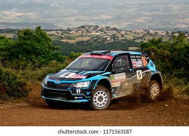 SARDINIA, ITALY - JUN 10: Polish driver Lukasz Pieniazek and his codriver Przemyslaw Mazur in a Skoda Fabia R5 race in the Rally Italia Sardegna 2018, on Jun 10, 2018 in Sardinia, Italy.