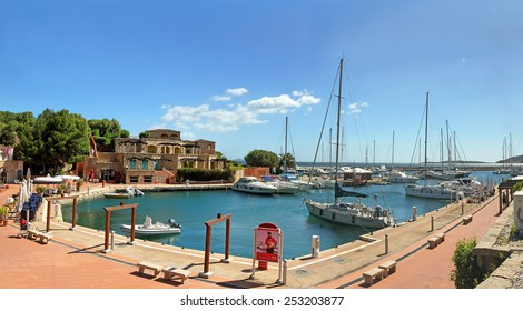 "SARDINIA, ITALY - MAY 11: Yachts anchored at the Marina di Portisco on May 11, 2013 in the province of Olbia-Tempio. Northern Sardinia, ""Costa Smeralda"" famous tourist area."