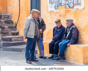 Sardinia, Italy - May 5 2018: group of male elderly Sardinian villages talking on the street