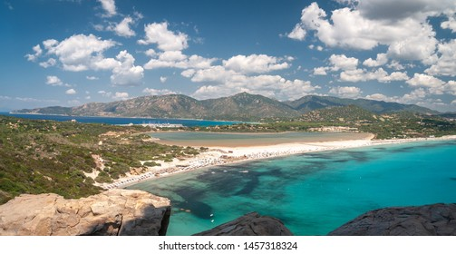 Sardinia, Villasimius. Panoramic view of Porto Giunco beach with turquoise sea water. Porto Giunco is also known as the beach of the two seas due to the presence of the Nottieri pond behind the beach