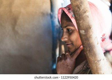 Sariska, India : February 19th, 2015 - Shot of an Indian woman wearing a traditional clothing smiling and looking interested