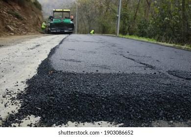 Sariyer, istanbul - Turkey - 25 December 2020 : Old road repair and asphalt pavement asphalt pavement machine and workers