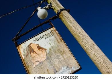 Sark, Channel Islands, United Kingdom - : battered old British pub sign