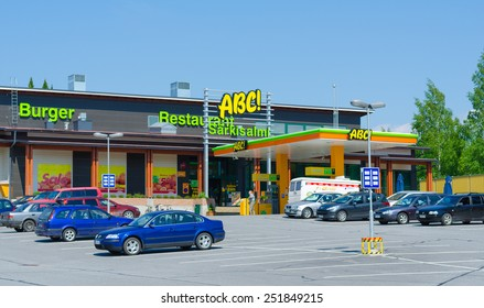 SARKISALMI, FINLAND - JUNE 1, 2011: Several cars are parked at an ABC service station. The highly developed chain is owned by the S Group, a Finnish retailing cooperative organization.
