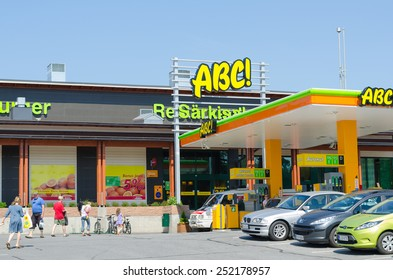 SARKISALMI, FINLAND - JUNE 1, 2011: Unidentified people go in an ABC service station. The highly developed chain is owned by the S Group, a Finnish retailing cooperative organization.
