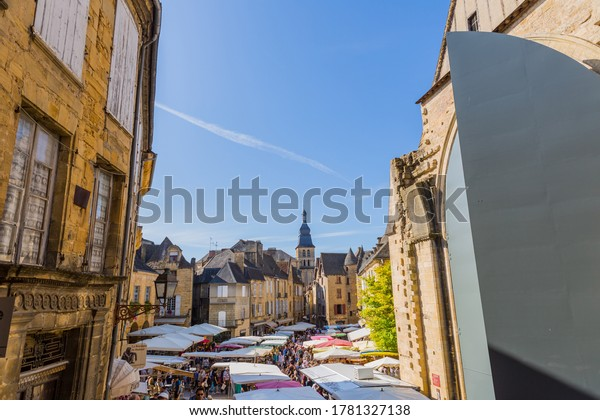 Sarlat-la-Caneda, France - August 11, 2019: Market day in the old medieval town of Sarlat-la-Caneda, Dordogne, France.