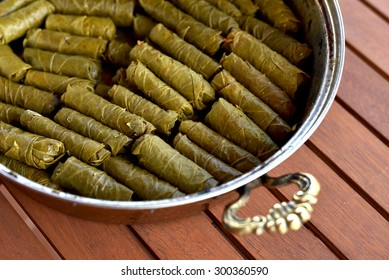 Sarma dish in a pot - Rice and mint wrapped in grape vine leaves.