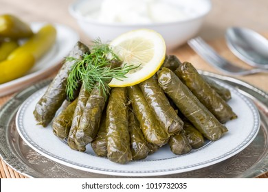 Sarma, stuffed grape leaves in a plate, traditional turkish cuisine.