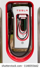 SARN, UNITED KINGDOM - AUGUST 2, 2018 : A row of Tesla Superchargers at the Sarn Park motorway services off the M4 near Bridgend in Wales.