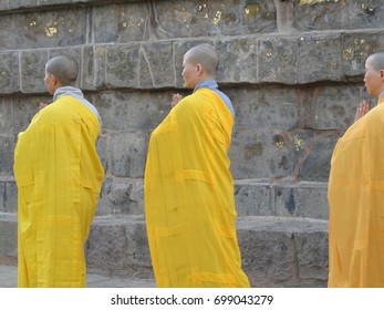 SARNATH INDIA - Nov 6,  2009 - Japanese monks perform Buddhist rituals atDharmeka Stupa atSarnath, India, Asia