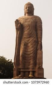 Sarnath, Uttar Pradesh/India- December 28, 2016: Tall statue of Lord Buddha at Sarnath, Uttar Pradesh