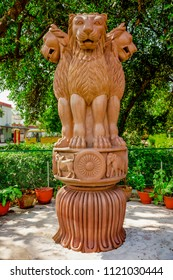 Sarnath,January,2,2012: Varanasi, Uttar Pradesh, India. Famous sculpture of lion capital of  Emperor Ashoka representing  Natioal symbol displayed in garden at Sarnath,Uttar Pradesh ,India