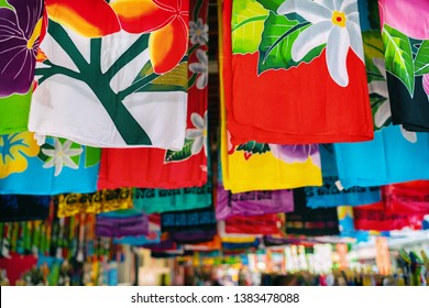Sarong skirts shop at city market of Papeete, Tahiti, French Polynesia. Colorful clothing pareo wrap hanging for sale as handmade tourism souvenir.