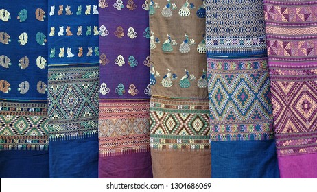 A lot of sarongs.Colorful sarongs on sale in the market.Sarongs for women.Cloth for women.