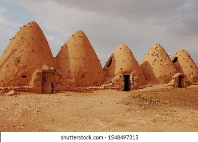 Sarouj, Hama, Syria - September 23, 2008: Interesting architecture of beehive houses in the desert of Sarouj