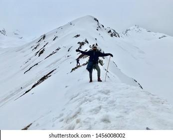 SARPASS, KASOL, HIMACHAL PRADESH, INDIA MAY 2019 boy on the pass enjoyed trekking