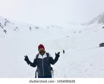 SARPASS, KASOL,HIMACHAL PRADESH, INDIA MAY 2019 Manvendra Singh after crossing Sarpass and sliding down and tierd of whole way