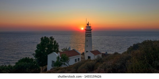 Sarpincik Lighthouse at sunset. The beauty of the Aegean sea and the sunset can be used as a background. Izmir Turkey.