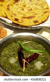 Sarson ka saag is a preparation from mustard leaves and slightly mixed with spinach. A Punjabi cuisine, eaten with makkeki roti, bread made from corn flour on disc-shaped frying pan called tava.