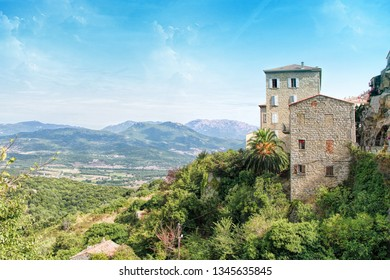 Sartene old town with colorful old houses and green trees, Corsica, France, Europe.