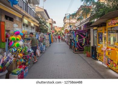Sarti, Greece - September 19: View of the Greek street with shops and tourists in the touristic place Sarti on Sithonia peninsula of Chalkidiki. The Summer. A Sunny day. September, 19 2017