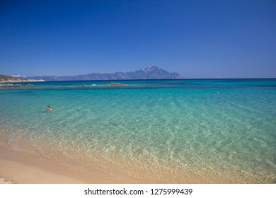 Sarti, Greece - September, 21: Amazing landscape with crystal clear turquoise water and the mountain Athos in the background in Sarti village on Sithonia peninsula of Chalkidiki. September, 21 2017