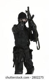 SAS Soldier/Policeman aiming a gun at the viewer
