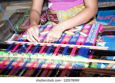 Sasak tribe lady weaving, Sade, Lombok, Indonesia
