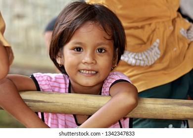 Sasak tribe little girl.3th November 2010. Sade village. Lombok Island. Indonesia. Asia.